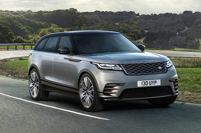 Range Rover Velar Medium Suv driving on road