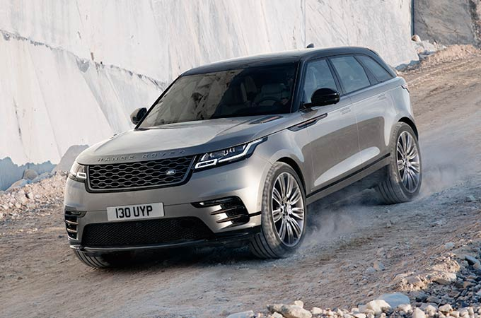 Range Rover Velar Driving on rocky road medium SUV