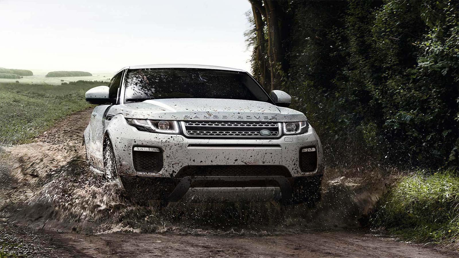 Range Rover Evoque driving safely on a muddy track. 19MY Shown.