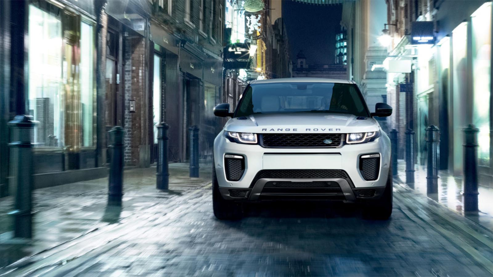 Range Rover Evoque driving in a narrow street. 19MY Shown.