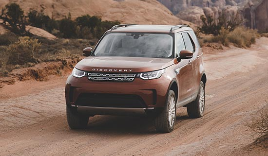 Indus Silver Discovery driving through the red cliffs of Utah
