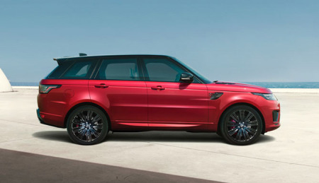 A hybrid vehicle: The Range Rover Sport driving in the city