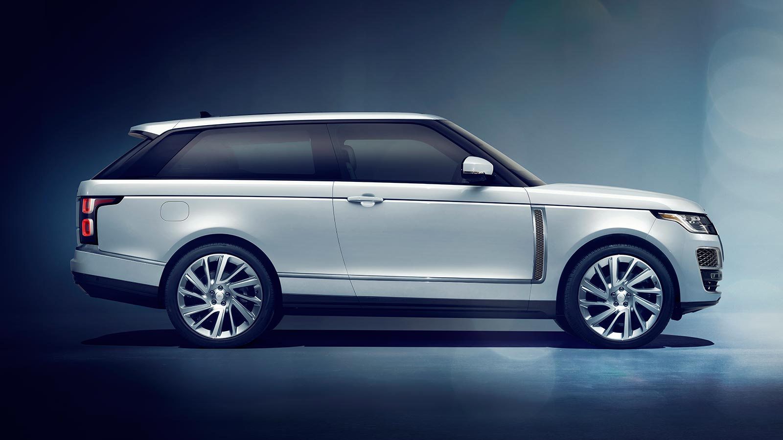 The Range Rover SV Coupe in Valloire White with 23 inch two tone wheels side profile