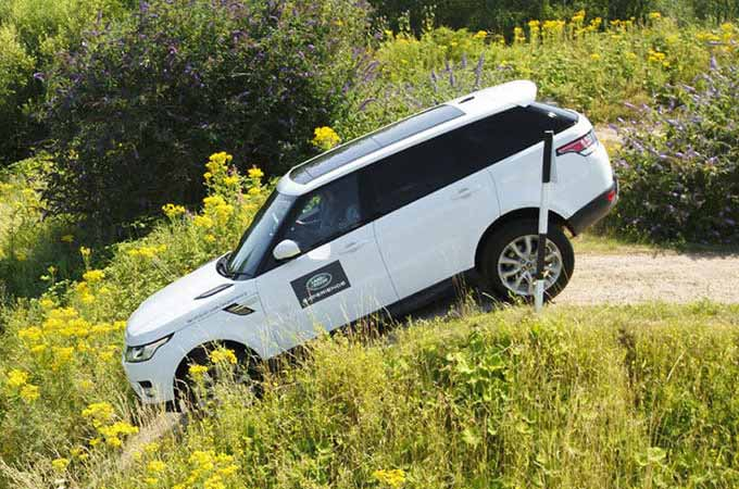 Land Rover Range Rover Sport Luxury SUV tackles obstacles