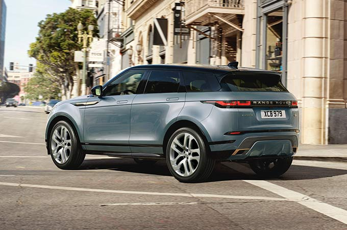 New Range Rover Evoque driven on city road.